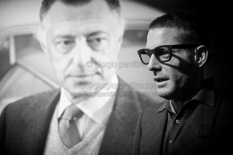 Lapo Elkann stands close to his Grandfather Giovanni Agnelli's portrait  during the visit of Agnelli's car exhibition at the Car Museum of Turin, Italy, March 12, 2013.
