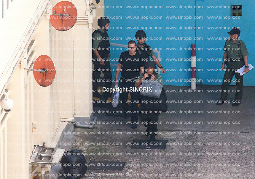 British ex-banker Rurik Jutting walks through a courtyard at the Lai Chi Kok Reception Centre shortly before boarding a high security prison van which will bring him to his trial at the High Court of Hong Kong for the alleged killing of two Indonesian women in October 2014, <br /> Hong Kong, China, 01 November 2016.