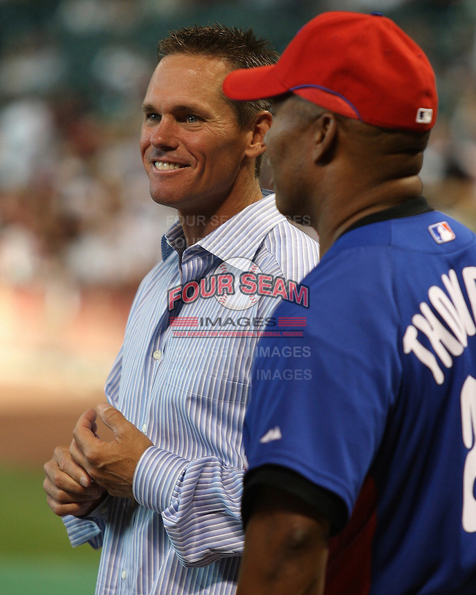 Former Astros star Craig Biggio visits with Phillies hitting coach Milt Thompson on Friday May 23rd at Minute Maid Park in Houston, Texas. Photo by Andrew Woolley / Baseball America.