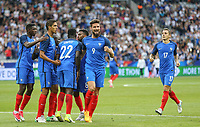 Olivier Giroud (9) (Arsenal) of France punches the air as French players celebrate with goalscorer Samuel Umtiti (Barcelona) of France during the International Friendly match between France and England at Stade de France, Paris, France on 13 June 2017. Photo by David Horn/PRiME Media Images.