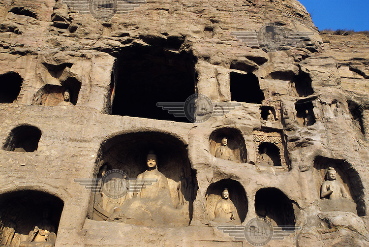 Sculptures carved into the rockface at the Yungang Grottoes, a series of ancient Buddhist caves constructed around 460-525 AD, which are a designated UNESCO World Heritage Site.....