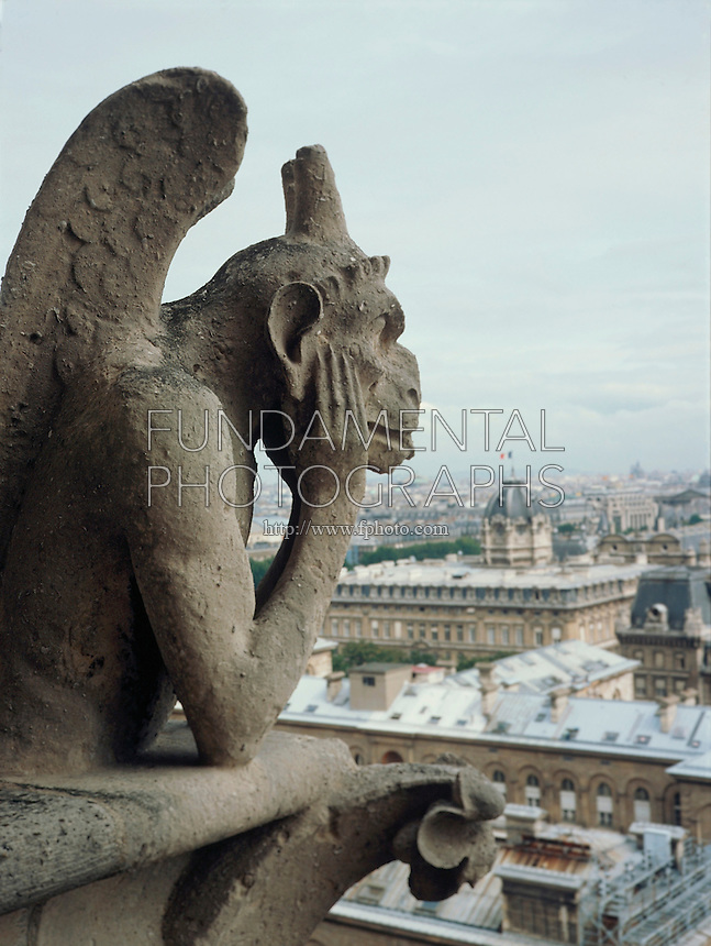 ACID RAIN (SO2) DAMAGE: LIMESTONE GARGOYLES<br /> Notre Dame, Paris, France SO2 (sulfuric dioxide) combines with atmospheric moisture (H20), yielding acid rain, or sulfuric acid (H2SO4).  Calcium carbonate in limestone statuary dilutes the sulfuric acid to form calcium sulfate, corroding the stone.