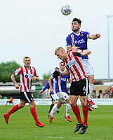 Lincoln City's Elliott Whitehouse vies for possession with Exeter City's Jordan Moore-Taylor<br /> <br /> Photographer Chris Vaughan/CameraSport<br /> <br /> The EFL Sky Bet League Two Play Off First Leg - Lincoln City v Exeter City - Saturday 12th May 2018 - Sincil Bank - Lincoln<br /> <br /> World Copyright &copy; 2018 CameraSport. All rights reserved. 43 Linden Ave. Countesthorpe. Leicester. England. LE8 5PG - Tel: +44 (0) 116 277 4147 - admin@camerasport.com - www.camerasport.com