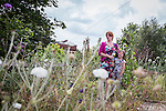 © Joel Goodman - 07973 332324 . 27 July 2013 . Hulme Community Garden Centre , Old Birley Street , Hulme , Manchester M15 , UK . Mum Kerrie Wilson with daughter Amy Wilson (eight) (both correct) (from Rusholme) enjoy the roof garden . Hulme is Where the Art Is festival . Photo credit : Joel Goodman