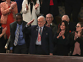 Former astronaut Buzz Aldrin salutes after being recognized as United States President Donald J. Trump delivers his second annual State of the Union Address to a joint session of the US Congress in the US Capitol in Washington, DC on Tuesday, February 5, 2019.<br /> Credit: Alex Edelman / CNP