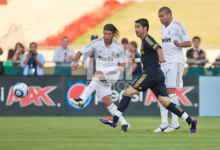 LOS ANGELES, CA – July 16, 2011: Sergio Ramos (4) and Pepe (3) of Real Madrid and Juan Pablo Angel (9) of the LA Galaxy during the match between LA Galaxy and Real Madrid at the Los Angeles Memorial Coliseum in Los Angeles, California. Final score Real Madrid 4, LA Galaxy 1.