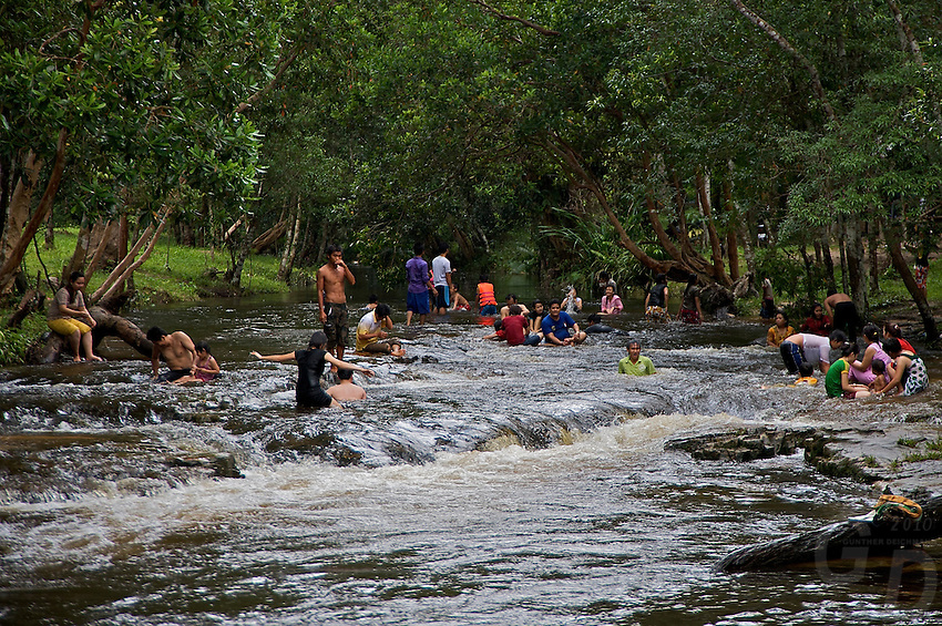 Local Cambodians swimming in the River of a thousand Lingas, Phom Kulen, Cambodia