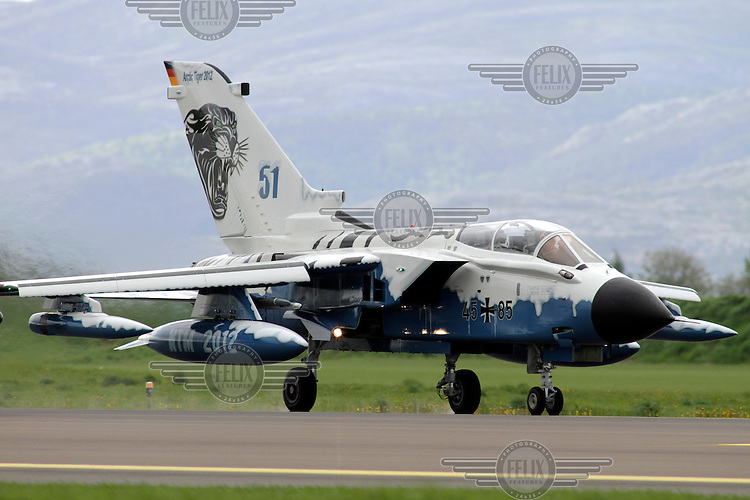 A German Tornado with tiger paint scheme. Nato Tiger Meet is an annual gathering of squadrons using the tiger as their mascot. While originally mostly a social event it is now a full military exercise. Tiger Meet 2012 was held at the Norwegian air base Ørlandet.
