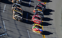 Nov. 1, 2009; Talladega, AL, USA; NASCAR Sprint Cup Series driver Kyle Busch (18) leads the field during the Amp Energy 500 at the Talladega Superspeedway. Mandatory Credit: Mark J. Rebilas-