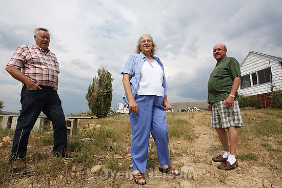 Scofield - People who have owned property and houses along the shores of the Scofield Reservoir for over 50 years are now being told by the federal government that they don't really own those places and must leave. The Mancina family could lose the cabin that's been in their family for over fifty years. Left to right, John Lamb, Judy Mancina Lamb, Paul Mancina, Thursday, September 3 2009.