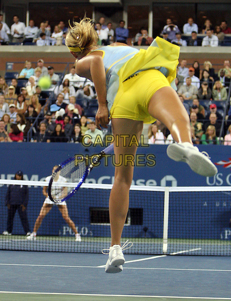 MARIA SHARPOVA.Plays Nadia Petrova at The US Open Tennis Tournament held at Flushing Meadows, Sharapova won 7-5,4-6, 6-4..New York, 7th September 2005.full length court competition white yellow racket bum knickers leg pants sport.www.capitalpictures.com.sales@capitalpictures.com.© Capital Pictures.