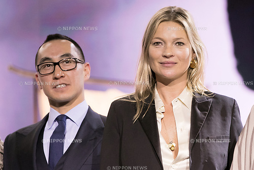 (L to R) Lawrence Ho chairman and CEO of Melco Resorts and Entertainment Ltd. and model Kate Moss, attend the opening ceremony for the KIMONO ROBOTO exhibition at Omotesando Hills on November 30, 2017, Tokyo, Japan. The exhibition features 13 kimonos created by experts using traditional methods and a humanoid robot dressed in traditional kimono performing in the middle of the hall. The exhibition runs til December 10. (Photo by Rodrigo Reyes Marin/AFLO)