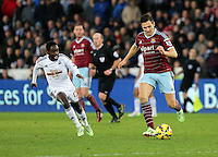 Pictured L-R: Nathan Dyer of Swansea against Stewart Downing of West Ham Saturday 10 January 2015<br />