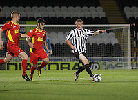 Jon Robertson on the ball being chased by Faissel El Bkhtaouio in the St Mirren v Dunfermline Athletic Clydesdale Bank Scottish Premier League U20 match played at St Mirren Park, Paisley on 2.10.12.