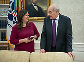 White House Press Secretary Sarah Huckabee Sanders and White House Chief of Staff John Kelly in the Oval Office as United States President Donald J. Trump signs the Cybersecurity and Infrastructure Security Agency Act in the Oval Office of the White House in Washington, DC on Friday, November 16, 2018.  The President also took questions from reporters.<br /> Credit: Ron Sachs / Pool via CNP