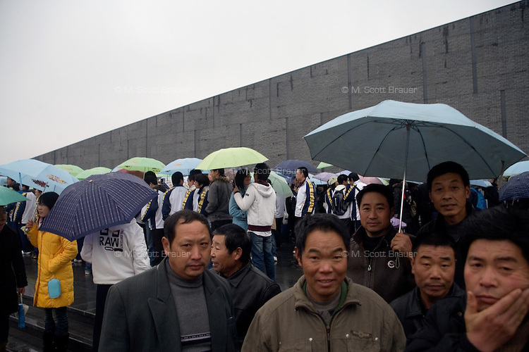 Visitors line up to visit the Memorial Hall of the Nanjing Massacre in Nanjing, Jiangsu, China on Dec. 13, 2009.  On Dec. 13, 2009, thousands of people visited The Memorial Hall of the Nanjing Massacre in Nanjing, Jiangsu, China, to remember those who died at the hands of Japanese soldiers in 1937-8.  The day marked the 72nd anniversary of the start of the massacre. The historical account has always been mired in controversy, and differing opinions on what actually happened have been a consistent obstacle to relations between China and Japan.  China's official account of history states that 300,000 people were killed by Japanese forces over a 6-week period starting Dec. 13, 1937