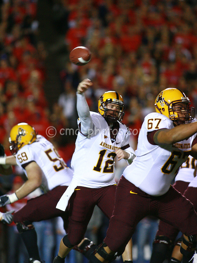 Dec 6, 2008; Tucson, AZ, USA; Arizona State Sun Devils quarterback Rudy Carpenter (12) throws a pass while tackle Jon Hargis (59) and guard Shaun Lauvao (67) provide protection in the first quarter of a game against the Arizona Wildcats at Arizona Stadium.