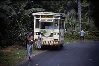 A man wearing a lungi carries two ice cream cones in Sri Lanka in 1996.