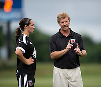 Holly King (16) of the D.C. United Women listens to head coach Mike Jorden during the game at the Maryland SoccerPlex in Boyds, Maryland.  The D.C. United Women defeated the Virginia Beach Piranhas, 3-0, to advance to the W-League Eastern Conference Championship.