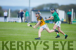 Abbeydorney's Michael Slattery been tackled for possession by Conor Murphy of Ballyduff in the Minor Hurling Championship semi final.