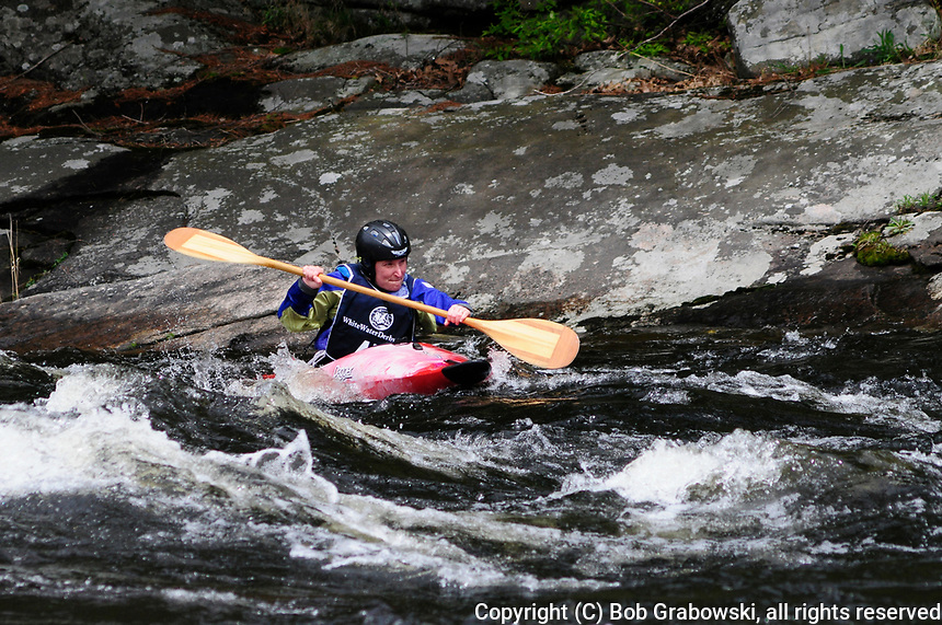 Kayaker in the Hudson River White Water Derby in North Creek, New York