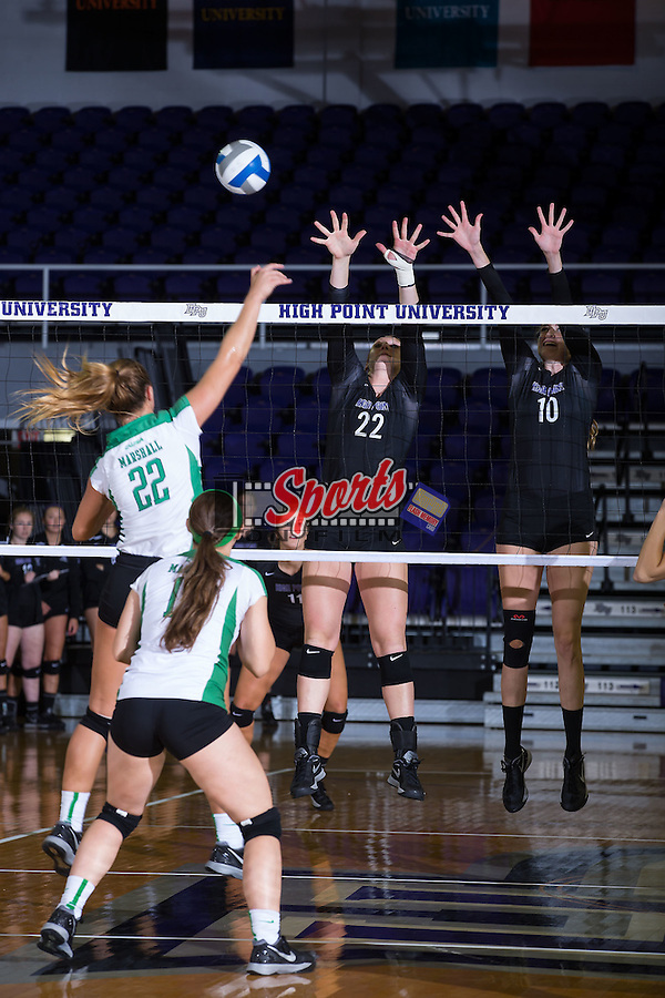 Molly Livingston (22) and Savannah Angel (10) of the High Point Panthers attempt to block the attack by Cassie Weaver (22) of the Marshall Thundering Herd at the Panther Invitational at the Millis Athletic Center on September 12, 2015 in High Point, North Carolina.  The Thundering Herd defeated the Panthers 3-2.   (Brian Westerholt/Sports On Film)