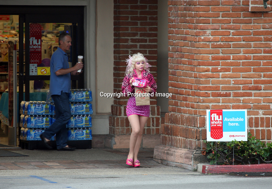 September 7th 2010 .. Angelyne picked up some drugs at CVS pharmacy in Malibu California. Angelyne tried to sell some of her posters and tshirts to a group of girls taking pictures by her pink Corvette & a gas station worker. ..AbilityFilms@yahoo.com.805-427-3519.www.AbilityFilms.com