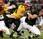 SIOUX FALLS, SD - SEPTEMBER 8: Nicholas Truen #33 from Northern State is brought down by Brian Mayberry #91 from the University of Sioux Falls in the first half of their game Saturday night at Bob Young Field in Sioux Falls. (Photo by Dave Eggen/Inertia)