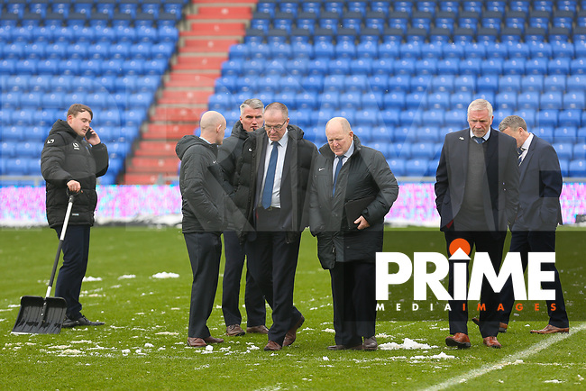 Match officials inspect the pitch ahead of  the Sky Bet League 1 match between Oldham Athletic and Northampton Town at Boundary Park, Oldham, England on 9 December 2017. Photo by Juel Miah / PRiME Media Images.