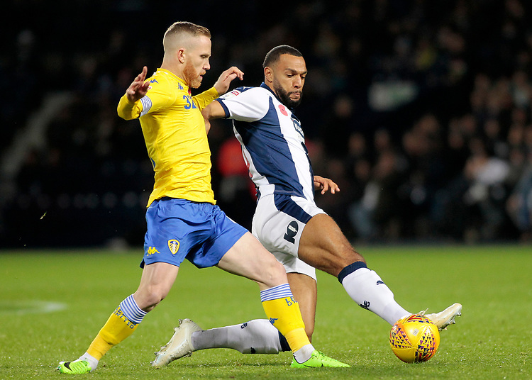 Leeds United's Adam Forshaw vies for possession with West Bromwich Albion's Matt Phillips<br /> <br /> Photographer David Shipman/CameraSport<br /> <br /> The EFL Sky Bet Championship - West Bromwich Albion v Leeds United - Saturday 10th November 2018 - The Hawthorns - West Bromwich<br /> <br /> World Copyright © 2018 CameraSport. All rights reserved. 43 Linden Ave. Countesthorpe. Leicester. England. LE8 5PG - Tel: +44 (0) 116 277 4147 - admin@camerasport.com - www.camerasport.com