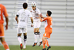 28 April 2012: San Antonio's Aaron Pitchkolan (center) heads the ball over Carolina's Jason Garey (right) toward teammate Kevin Harmse (RSA) (left). The San Antonio Scorpions defeated the Carolina RailHawks 1-0 at WakeMed Soccer Stadium in Cary, NC in a 2012 North American Soccer League (NASL) regular season game. It was the first win for the expansion team from San Antonio.