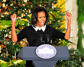 First lady Michelle Obama makes remarks at the first preview of the 2011 White House Christmas decorations. The theme for this year is Shine, Give, Share - celebrating the countless ways we can lift up those around us, put our best self forward in the spirit of the season, spend time with friends and family, celebrate the joy of giving to others, and share our blessings with all.  The theme translates to the holiday décor on several levels. There is the literal translation through the use of shiny elements – star motifs, quartz and metallics like copper, aluminum and mirrored paper. There is also a conceptual connection – we're inviting visitors to give their thanks to members of our military, and have once again invited guest artists to share their talents working with the White House. This year's décor also includes handmade decorations crafted from simple materials – paper, felt, and even recycled cans. These are projects that anyone can do at home using readily available materials that are inexpensive or free..Credit: Ron Sachs / CNP