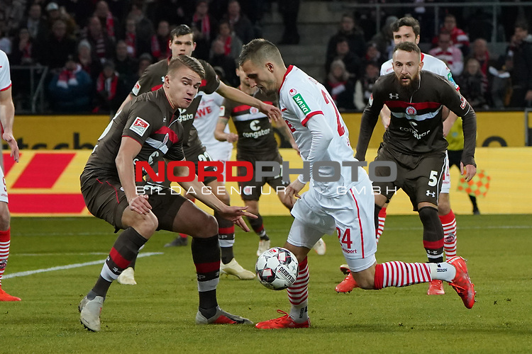 08.02.2019, RheinEnergieStadion, Koeln, GER, 2. FBL, 1.FC Koeln vs. FC St. Pauli,<br />  <br /> DFL regulations prohibit any use of photographs as image sequences and/or quasi-video<br /> <br /> im Bild / picture shows: <br /> Dominick Drexler (FC Koeln #24), im Zweikampf gegen  Florian Carstens (St Pauli #38), <br /> <br /> Foto &copy; nordphoto / Meuter