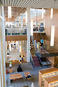 An interior view of San Mateo Library with eco friendly features. Extensive use of windows provides daylight into the building making for a pleasant user experience and reducing energy consumption. The San Mateo Public Library integrates significant green building practices and achieved LEED Silver certification. Green features include extensive daylighting, efficient underfloor air supply, venting windows, low VOC materials, native plant landscaping, and much more. San Mateo, California, USA