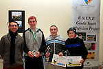 Stephen Harrison makes a presentation for Football to Dean Johnson, Craig Curran and Dillion O'Brien at the Boyne Garda Youth Project Awards in the Holy Family Community Centre...Photo NEWSFILE/Jenny Matthews..(Photo credit should read Jenny Matthews/NEWSFILE)