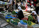 Palestinian women vendors sell their goods in front of Damascus Gate in Jerusalem's Old City on June 19, 2010. Photo by Mahfouz Abu Turk
