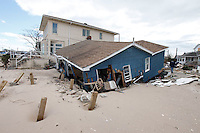 Damage caused by Hurricane Sandy, Breezy Point, Queens, NY, five days after the hurricane hit..Breezy Point is a beachfront neighborhood located on the western end of the Rockaway peninsula, between Rockaway Inlet and Jamaica Bay on the landward side, and the Atlantic Ocean.