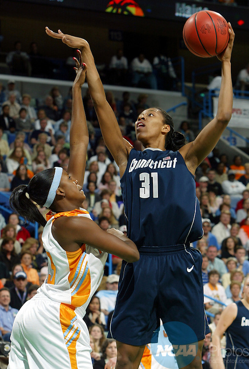 06 APR 2004:  University of Connecticut center Jessica Moore (31) puts up a hook shot over Tennessee forward Shyra Ely (43) during the Division I Women's Basketball Championship held at the New Orleans Arena in New Orleans, LA.  The Huskies defeated Tennessee 70-61 to win the national championship.  Jay L. Clendenin/NCAA Photos