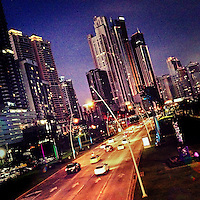 Illuminated skyscrapers are seen along Avenida Balboa, a seafront highway going through the commercial and financial center of Panama City, Panama, 25 January 2015.