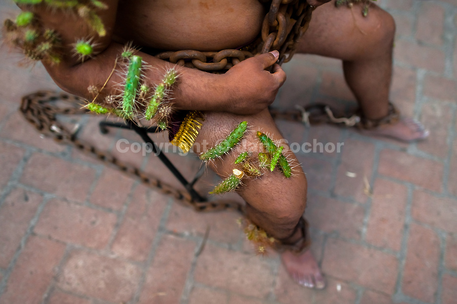 A chained Catholic penitent, wearing cactus spines stuck to his body, prepares to take part in the Holy week procession in Atlixco, Mexico, 30 March 2018. Every year on Good Friday, dozens of anonymous men of all ages voluntarily undergo pain and suffering during the religious procession of the 'Engrillados' (the Shackled ones) in Puebla state, central Mexico. Wearing heavy chains on their shoulders covered with prickling cacti while being burned by the hot midday sun, they recall Jesus Christ's death by crucifixion and demonstrate their religiosity and faith.