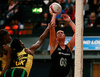 17.1.2014 New Zealand's Catherine Latu is put under pressure by Jamaica's Stacian Facey during their netball test match in London, England. Mandatory Photo Credit (Pic: Tim Hales). ©Michael Bradley Photography.