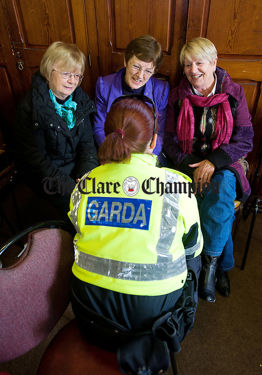 Carmel  Ui Ceallaigh, Maura Rynne and Maura Healy chatting with Garda Deirdre Doherty at a coffee morning in Ennis Cathedral, organised by Colaiste Muire Ennis Transition Year Students in conjunction with An Garda Siochana as part of their Positive Ageing YSI project. Photograph by John Kelly.