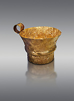 Mycenaean gold cup with spiral decorations, Grave V, Grave Circle A,  Mycenae, Greece. National Archaeological Museum of Athens.  Grey Background<br /> <br /> <br /> An elegant precious gold cup hammered from thick gold to created a simple elegant design. This Mycenaean gold cup demonstrates how advance Mycenaean metalworking was in the 16th century BC. The value of the cup would have been extermely high so must have graced the table of a Mycenaean noble perhaps even a v king.