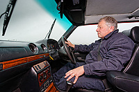 Martin Buckley in the driving seat of the Mercedes W123 series 230TE estate version, outside the Penderyn Whisky Distillery in south Wales, UK. Tuesday 19 June 2018