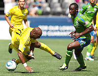 Columbus Crew forward Emilio Renteria, left, is tripped up Seattle Sounders FC defender Jhon Kennedy Hurtado during play at CenturyLink Field in Seattle Saturday Aug. 27, 2011. The Sounders FC won the game 6-2.