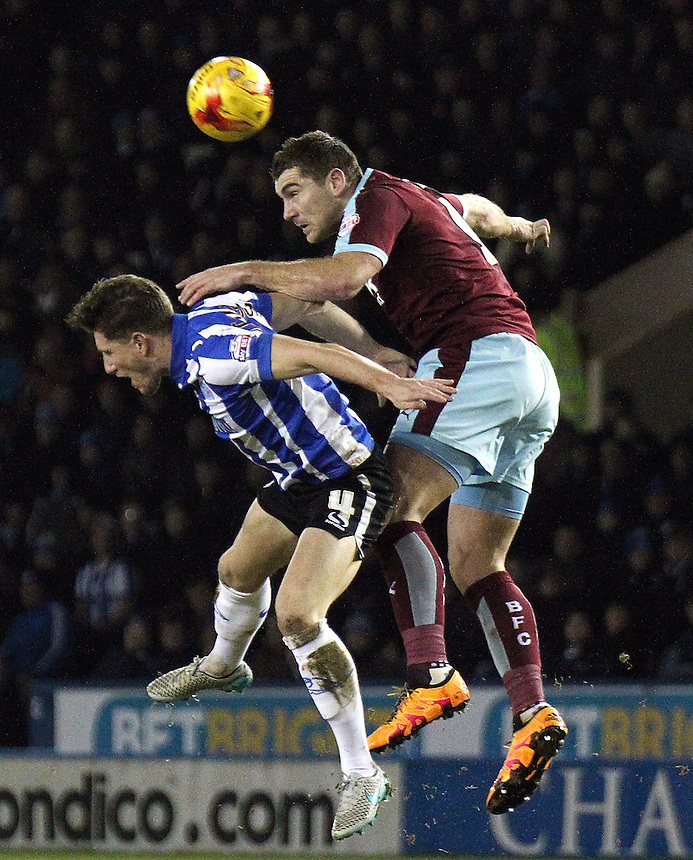 Burnley's Sam Vokes vies for possession with Sheffield Wednesday's Sam Hutchinson<br /> <br /> Photographer Rich Linley/CameraSport<br /> <br /> Football - The Football League Sky Bet Championship - Sheffield Wednesday v Burnley - Tuesday 2nd February 2016 - Hillsborough - Sheffield<br /> <br /> &copy; CameraSport - 43 Linden Ave. Countesthorpe. Leicester. England. LE8 5PG - Tel: +44 (0) 116 277 4147 - admin@camerasport.com - www.camerasport.com