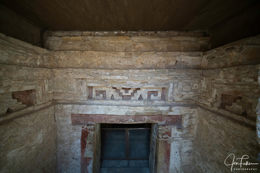 Mixtec-style stone fretwork with original red paint in the entrance to Tomb 1, the burial site of Lord Nine Flower, at the ruins of the Zapotec city of Zaachila in the Central Valley of Oaxaca, Mexico.