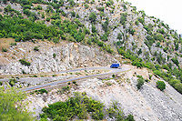 A steep winding road with hairpin curve with a lorry truck going uphill near the village Zitomislici. Federation Bosne i Hercegovine. Bosnia Herzegovina, Europe.