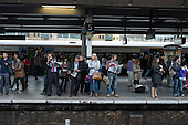 Commuters waiting on a platform at London Bridge station.