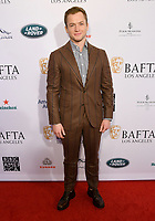 04 January 2020 - Beverly Hills, California - Taron Egerton. The 2020 BAFTA Los Angeles Tea Party held at Four Seasons Los Angeles . Photo Credit: Birdie Thompson/AdMedia